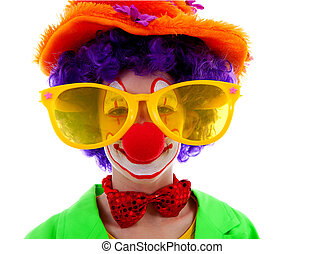 portrait of child dressed as colorful funny clown over white...