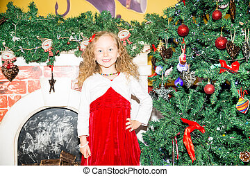 Portrait of child girl around a Christmas tree decorated. Kid on holiday new year