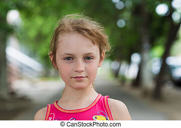 portrait of child girl with a sly look