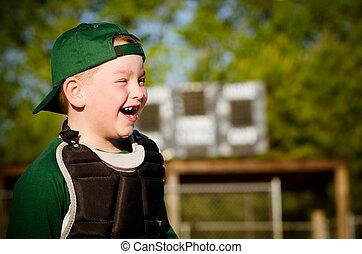 Portrait of child in catcher's gear