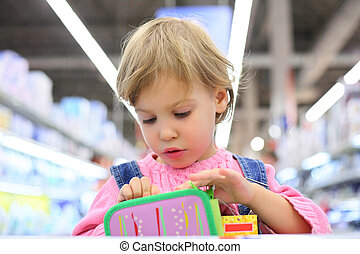 Portrait of child in shop