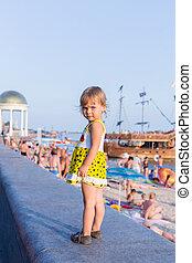 Portrait of child on the city beach