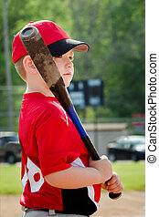 Portrait of child preparing to bat