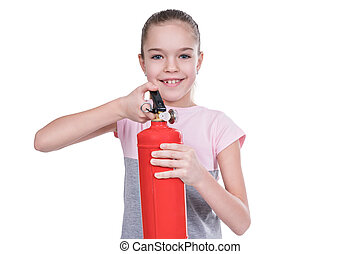 Portrait of child with a fire extinguisher