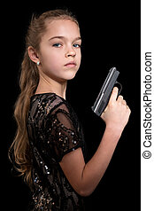 Portrait of child with a gun