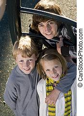 Portrait of children at park - Three children (10 to 15...
