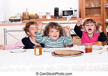 portrait of children eating at table