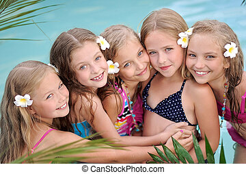 Portrait of children on the pool in summer