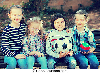 Portrait of children with ball outdoor. - Urban portrait of ...