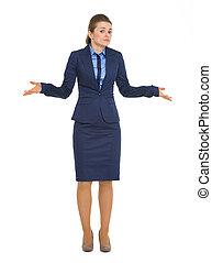 Portrait of clueless business woman shrugging shoulders