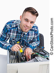 Portrait of computer engineer repairing cpu