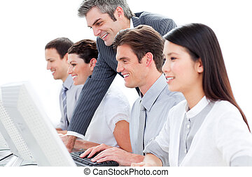 Portrait of concentrated customer service agents working in a call center