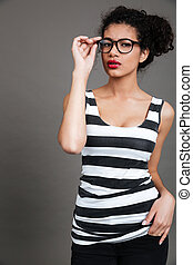 Portrait of confident african american young woman in glasses