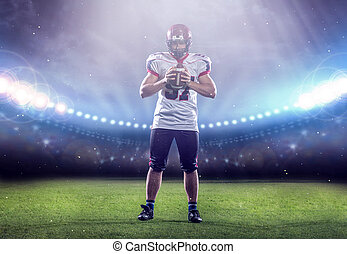 portrait of confident American football player standing on the field