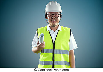 Portrait of confident asian young engineer wearing protective hard hat