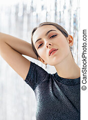 Portrait of confident beautiful woman on light background