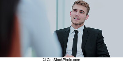 Portrait of confident business man talking with his collegue...
