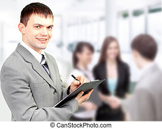 Portrait of confident business man holding document with...