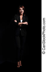 portrait of confident business woman. isolated on a dark background.
