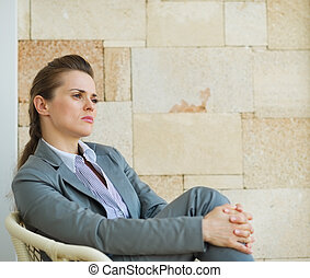 Portrait of confident business woman looking on copy space
