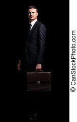 portrait of confident businessman isolated on a black background