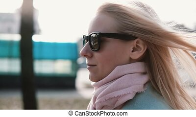 Portrait of confident Caucasian blonde girl 20s. Slow motion...