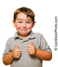 Portrait of confident child showing thumbs up isolated one white