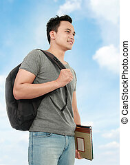college student with book and bag