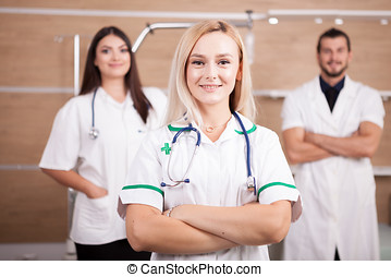 Portrait of confident doctor medical team with a blonde medic in