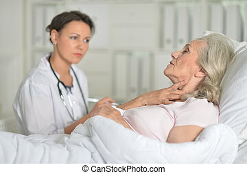 Portrait of confident doctor with senior patient