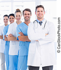 Portrait of confident happy group of doctors standing at the...