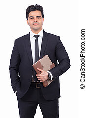 Portrait of confident Indian businessman with diary against white background