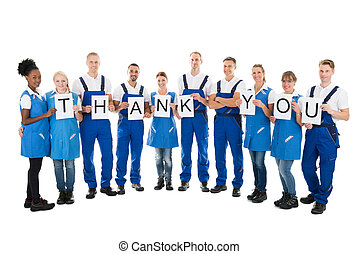 Portrait Of Confident Janitors Holding Thank You Sign