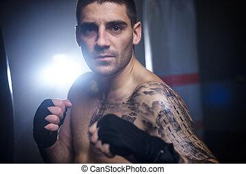 Portrait of confident male boxer