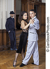 Portrait Of Confident Tango Dancers Performing In Restaurant