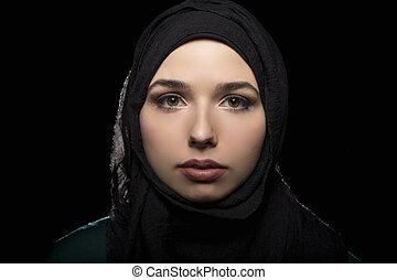 Portrait of Confident Woman Wearing a Black Hijab - Proud...