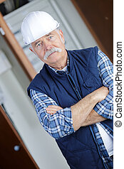 portrait of confident worker with arms crossed