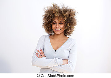 confident young african american woman smiling against white background with arms crossed