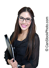 Portrait of confident young businesswoman with file folder in office