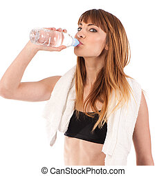 Portrait of confident young woman in sportswear holding a water