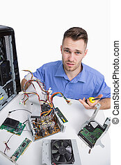 Portrait of confused computer engineer with cpu parts - ...