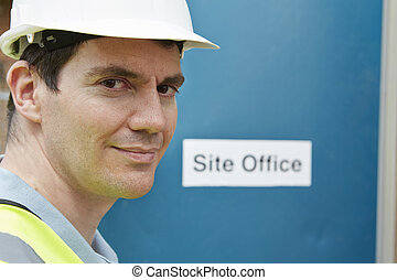 Portrait Of Construction Worker At Site Office