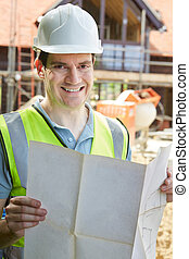 Portrait Of Construction Worker On Building Site Looking At House Plans