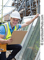 Portrait Of Construction Worker Preparing To Fit New Windows
