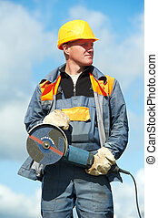 portrait of construction worker with grinder
