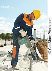 portrait of construction worker with perforator - Portarait...