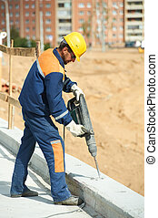 portrait of construction worker with perforator