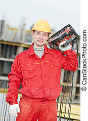 portrait of construction worker with saw