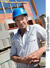 Portrait of construction worker with security helmet