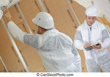 portrait of contractors assessing work site
